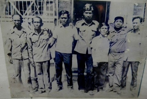 Survivors of S-21 (Tuol Sleng) Prison standing in fron of a Tuol Sleng building after Democratic Kampuchea Reproduced by kind permission of the Documentation Centre of Cambodia